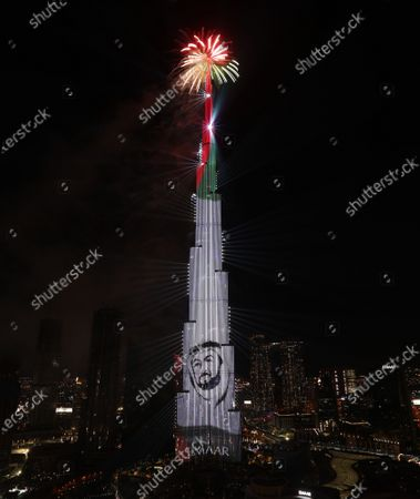 Fireworks illuminate the sky around Burj Khalifa, the tallest building in the world with portrait for President of UAE Sheikh Khalifa Bin Zayed Al Nahyan, during New Year's 2021 celebrations in the Gulf emirate of Dubai, United Arab Emirates, 01 January 2021.