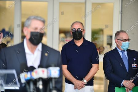 "Stock Image of Jose ""Pepe"" Diaz, Miami-Dade County Commissioner, Emilio Estefan and Don Steigman, Chief Operating Officer of Jackson Health system attend press conference outside of Lynn Rehab after the vaccination of the elderly with the Pfizer-BioNtech Covid-19, at Jackson Memorial Hospital on December 30, 2020 in Miami, Florida. Jackson Health System began Pfizer COVID-19 vaccinations for people 65 and older in Miami-Dade County."