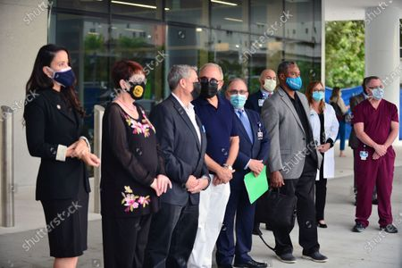 "Stock Photo of Danielle Cohen Higgins, Miami-Dade County Commissioner, Rebecca Sosa, Miami-Dade County Commissioner, Jose ""Pepe"" Diaz, Miami-Dade County Commissioner, Emilio Estefan, Don Steigman, Chief Operating Officer of Jackson Health system, Nat Moore, Luis Alfonso and Venessa Goodnow attend press conference outside of Lynn Rehab after the vaccination of the elderly with the Pfizer-BioNtech Covid-19, at Jackson Memorial Hospital on December 30, 2020 in Miami, Florida. Jackson Health System began Pfizer COVID-19 vaccinations for people 65 and older in Miami-Dade County."