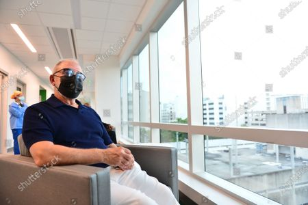 Music producer Emilio Estefan, 67, waits during a follow-up after getting his first dose of Pfizer-BioNtech COVID-19 vaccine from Nadia Johnson, RN from Jackson Health System, at Jackson Memorial Hospital-Christine E. Lynn Rehabilitation Center on December 30, 2020 in Miami, Florida. Jackson Health System began Pfizer COVID-19 vaccinations for people 65 and older in Miami-Dade County.