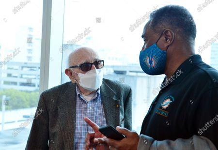 Stock Photo of Dr. Norman G. Einspruch, 88, a cardiology patient at Jackson Memorial Hospital and Nat Moore, 69, Miami Dolphins legend, waits during a follow-up after getting his first dose of Pfizer-BioNtech COVID-19 vaccine from Nadia Johnson, RN from Jackson Health System, at Jackson Memorial Hospital-Christine E. Lynn Rehabilitation Center on December 30, 2020 in Miami, Florida. Jackson Health System began Pfizer COVID-19 vaccinations for people 65 and older in Miami-Dade County.