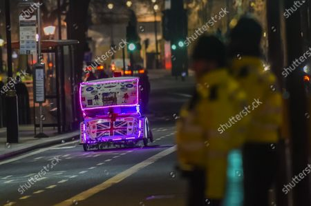 A union jack on a cycle rickshaw ridden by an immigrant outside parliament - The end of the Brexit transition period comes at 11pm on New Year's eve 2020 in Westminster.