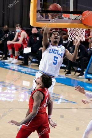 Guard Chris Smith (5) shoots over Utah forward Timmy Allen during the second half of an NCAA college basketball game, in Los Angeles