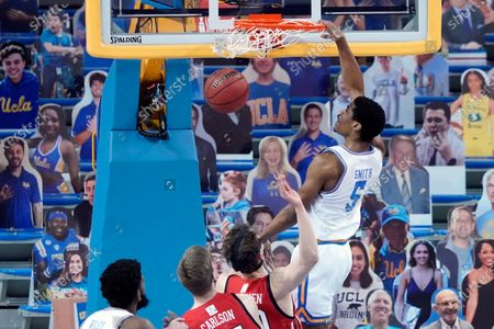 Guard Chris Smith (5) dunks against Utah during the first half of an NCAA college basketball game, in Los Angeles