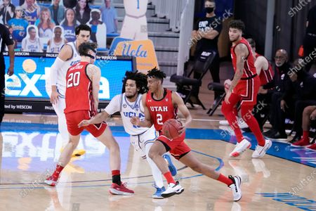 Utah guard Ian Martinez (2) is defended by UCLA guard Tyger Campbell during the second half of an NCAA college basketball game, in Los Angeles