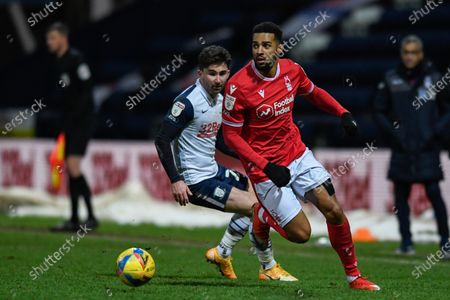 Cyrus Christie #2 of Nottingham Forest runs with the ball while under pressure from Sean Maguire #24 of Preston North End