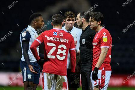 Darnell Fisher #2 of Preston North End and Ryan Ledson #18 of Preston North End speak to referee Tim Robinson