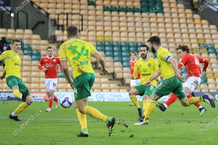 Callum Styles #4 of Barnsley shoots on goal, saved easily by Tim Krul #1 of Norwich City