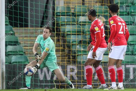 Jack Walton #1 of Barnsley punches clear a shot from Todd Cantwell #14 of Norwich City