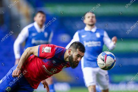 Bradley Johnson #4 of Blackburn Rovers heads the ball