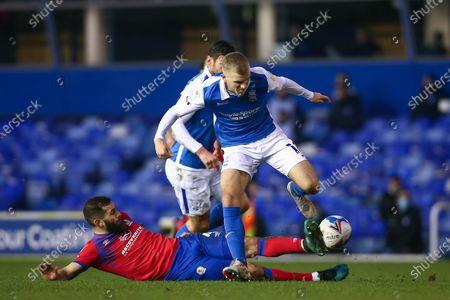 Riley McGree #18 of Birmingham City is tackled by Bradley Johnson #4 of Blackburn Rovers