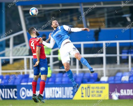 Lukas Jutkiewicz #10 of Birmingham City and Bradley Johnson #4 of Blackburn Rovers compete for the aerial ball