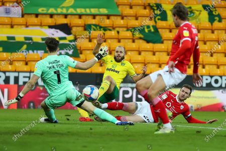 Teemu Pukki of Norwich City shot is saved by Jack Walton of Barnsley; Carrow Road, Norwich, Norfolk, England, English Football League Championship Football, Norwich versus Barnsley.