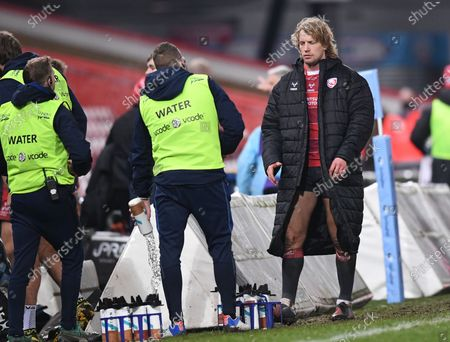 Billy Twelvetrees of Gloucester apologises after the match to the waterboy he pushed; Kingsholm Stadium, Gloucester, Gloucestershire, England; English Premiership Rugby, Gloucester versus Sale Sharks.