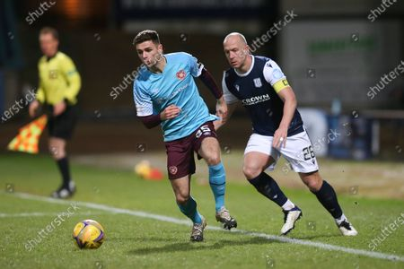 Jamie Brandon of Heart of Midlothian and Charlie Adam of Dundee; Dens Park, Dundee, Scotland; Scottish Championship Football, Dundee FC versus Heart of Midlothian.