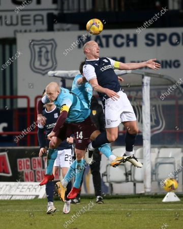 Charlie Adam of Dundee competes in the air with Steven Naismith of Heart of Midlothian; Dens Park, Dundee, Scotland; Scottish Championship Football, Dundee FC versus Heart of Midlothian.
