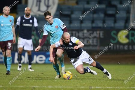 Charlie Adam of Dundee is fouled by Jamie Walker of Heart of Midlothian; Dens Park, Dundee, Scotland; Scottish Championship Football, Dundee FC versus Heart of Midlothian.