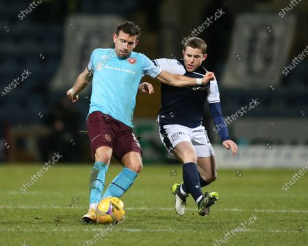 Oliver Lee of Heart of Midlothian challenges for the ball with Finlay Robertson of Dundee; Dens Park, Dundee, Scotland; Scottish Championship Football, Dundee FC versus Heart of Midlothian.