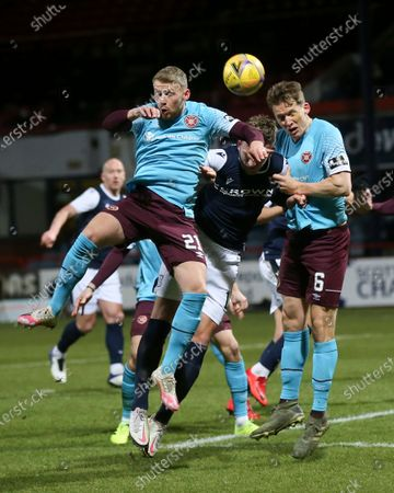 Stephen Kingsley and Christophe Berra of Heart of Midlothian compete in the air with Lee Ashcroft of Dundee; Dens Park, Dundee, Scotland; Scottish Championship Football, Dundee FC versus Heart of Midlothian.