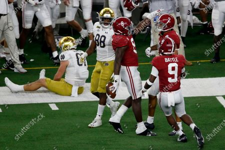 Alabama linebacker Christian Harris (8), defensive back Jordan Battle (9) and defensive back Patrick Surtain II (2) celebrate an interception by Harris on a pass intended for Notre Dame tight end Michael Mayer (87) as wide receiver Javon McKinley (88) looks on in the second half of the Rose Bowl NCAA college football game in Arlington, Texas