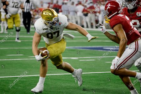 Notre Dame tight end Michael Mayer (87) gains yardage after a catch as Alabama defensive back Patrick Surtain II (2) moves in to make the stop in the second half of the Rose Bowl NCAA college football game in Arlington, Texas