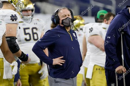 Notre Dame head coach Brian Kelly watches play against Alabama in the first half of the Rose Bowl NCAA college football game in Arlington, Texas