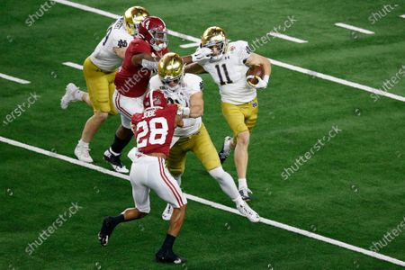 Alabama linebacker Christopher Allen (4) grabs the face mask of Notre Dame wide receiver Ben Skowronek (11) in the second half of the Rose Bowl NCAA college football game in Arlington, Texas