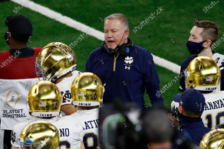 Notre Dame head coach Brian Kelly, center, on the sideline during the first half of the Rose Bowl NCAA college football game against Alabama in Arlington, Texas