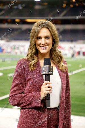 Stock Image of Allison Williams, sideline reporter with ESPN poses for a photo on the field at AT&T Stadium before the Rose Bowl NCAA college football game between Notre Dame and Alabama in Arlington, Texas