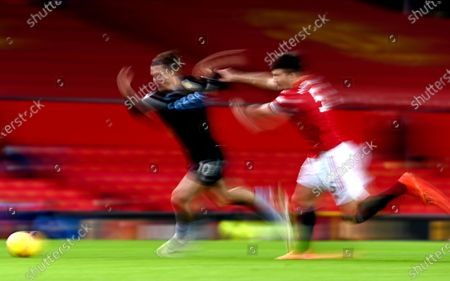 Harry Maguire (R) of Manchester United in action against Jack Grealish (L) of Aston Villa during the English Premier League soccer match between Manchester United and Aston Villa in Manchester, Britain, 01 January 2021.