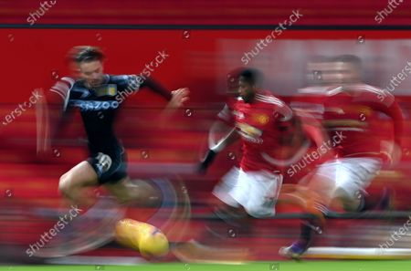 A picture taken with a slow shutter speed of Jack Grealish (L) of Aston Villa in action against Fred (C) of Manchester during the English Premier League soccer match between Manchester United and Aston Villa in Manchester, Britain, 01 January 2021.