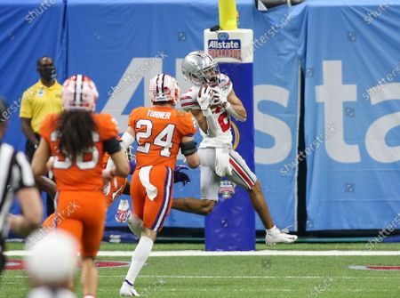 Ohio State receiver Chris Olave (2) hauls in a long touchdown pass in front of Clemson's Nolan Turner (24) during the Allstate Sugar Bowl Classic Playoff Semifinal game between the Clemson Tigers and the Ohio State Buckeyes at the Mercedes Benz Superdome in New Orleans, LA