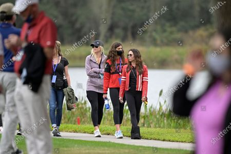 Elin Nordegren, left, Sam Alexis Woods, center, and Erica Herman follow Tiger Woods and his son Charlie on the 11th hole during the final round of the PNC Championship golf tournament, in Orlando, Fla