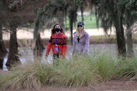 Stock Image of Elin Nordegren, and Sam Alexis Woods, left, follow Tiger Woods and Charlie Woods along the 18th fairway during the final round of the PNC Championship golf tournament, in Orlando, Fla