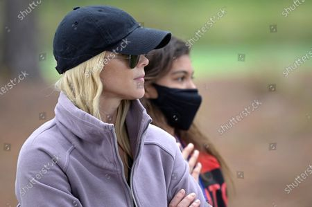 Elin Nordegren, left, and Sam Alexis Woods watch Tiger Woods and Charlie Woods on the 18th fairway during the final round of the PNC Championship golf tournament, in Orlando, Fla