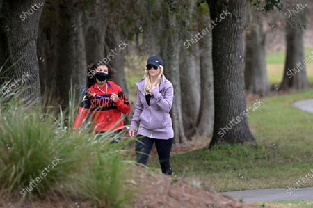 Stock Photo of Elin Nordegren, and Sam Alexis Woods, left, follow Tiger Woods and Charlie Woods along the 18th fairway during the final round of the PNC Championship golf tournament, in Orlando, Fla