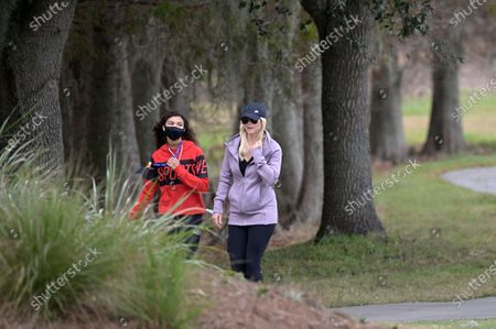 Stock Picture of Elin Nordegren, and Sam Alexis Woods, left, follow Tiger Woods and Charlie Woods along the 18th fairway during the final round of the PNC Championship golf tournament, in Orlando, Fla