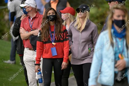 Elin Nordegren, right, and her daughter Sam Alexis Woods follow Tiger Woods and Charlie Woods on the fourth hole during the final round of the PNC Championship golf tournament, in Orlando, Fla