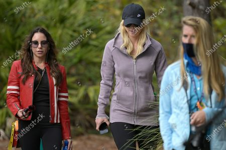 Elin Nordegren, center, and Erica Herman, left, follow Tiger Woods and Charlie Woods on the fourth hole during the final round of the PNC Championship golf tournament, in Orlando, Fla