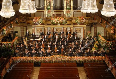 """Stock Image of The Vienna Philharmonic under the baton of Italian conductor Riccardo Muti perform during the 2021 Vienna Philharmonic New Year's Concert in Vienna, Austria, on Jan. 1, 2021. The New Year's Concert by Vienna Philharmonic took place in front of empty ranks in the """"Golden Hall"""" of the Musikverein in Vienna, the first time in its 81-year history since the event started in 1939."""