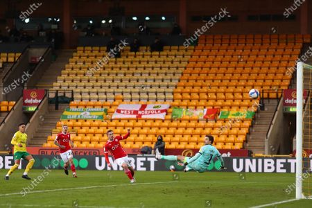 Luke Thomas of Barnsley beats Tim Krul of Norwich City but his effort rebounds back off the crossbar