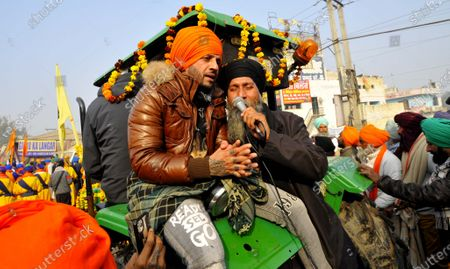 Punjabi singer Jazzy B joins members of the Nihang Sikh community during a Nagar Kirtan on New Year's Day at Singhu border, on January 1, 2021 in New Delhi, India.