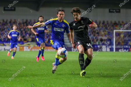 AFC Wimbledon midfielder Ethan Chislett (11) battles for possession with Lincoln City defender Joe Walsh (16) during the EFL Sky Bet League 1 match between AFC Wimbledon and Lincoln City at Plough Lane, London