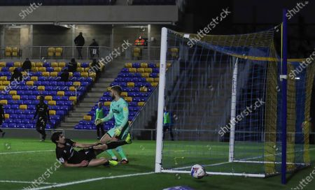 Lincoln City Defender Joe Walsh (16) jut misses during the EFL Sky Bet League 1 match between AFC Wimbledon and Lincoln City at Plough Lane, London