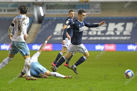 Millwall midfielder Shaun Williams (6)  runs forward during the EFL Sky Bet Championship match between Millwall and Coventry City at The Den, London