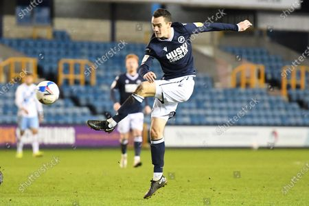 Millwall midfielder Shaun Williams (6)  misses the target during the EFL Sky Bet Championship match between Millwall and Coventry City at The Den, London