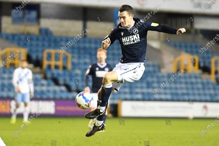Stock Picture of Millwall midfielder Shaun Williams (6)  misses the target during the EFL Sky Bet Championship match between Millwall and Coventry City at The Den, London