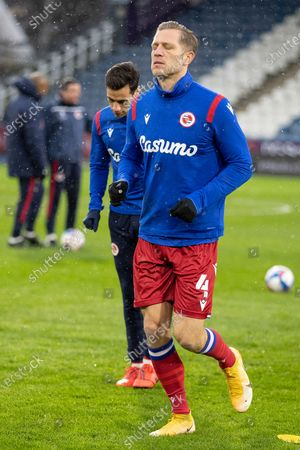 Reading defender Michael Morrison (4)warms up before the EFL Sky Bet Championship match between Huddersfield Town and Reading at the John Smiths Stadium, Huddersfield