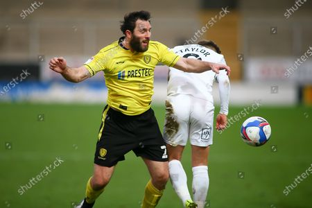 John-Joe O'Toole of Burton Albion (21) and Matty Taylor of Oxford United (9) battle for the ball during the EFL Sky Bet League 1 match between Burton Albion and Oxford United at the Pirelli Stadium, Burton upon Trent