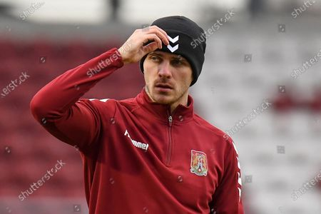 Portrait of Northampton Town forward Harry Smith (9) with his hand to his head during the EFL Sky Bet League 1 match between Northampton Town and Sunderland at the PTS Academy Stadium, Northampton